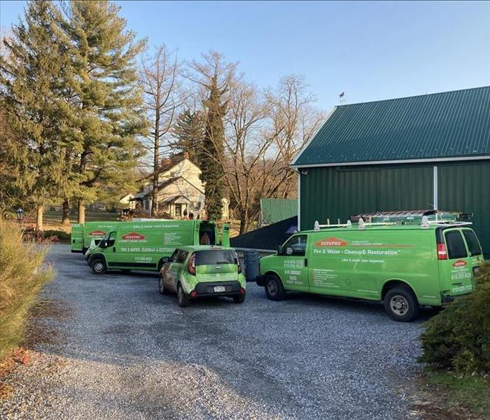 SERVPRO vehicles in parking lot