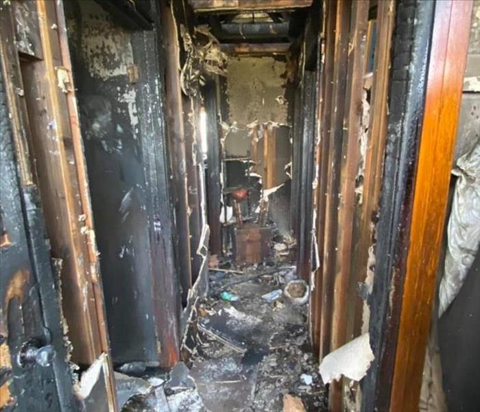 fire damage on walls, ceiling, floor
