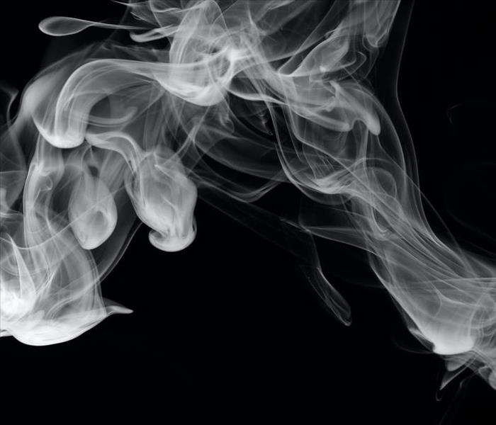 smoke in the air on black background