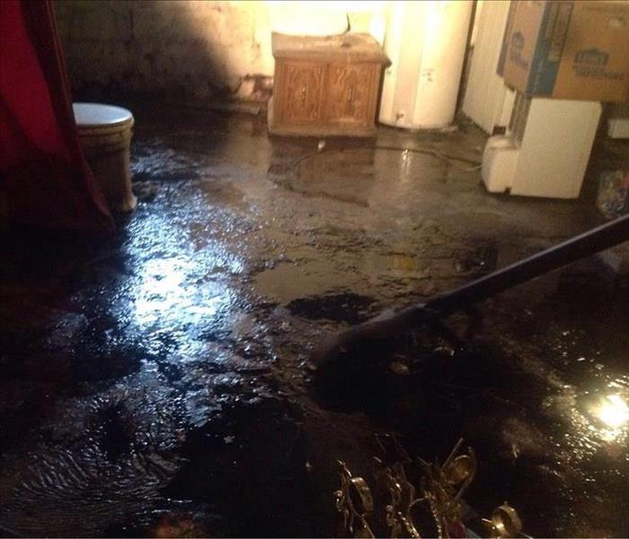 floor covered in water and being mitigated