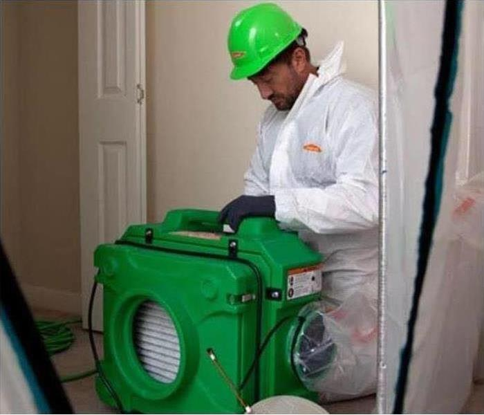 SERVPRO employee using equipment