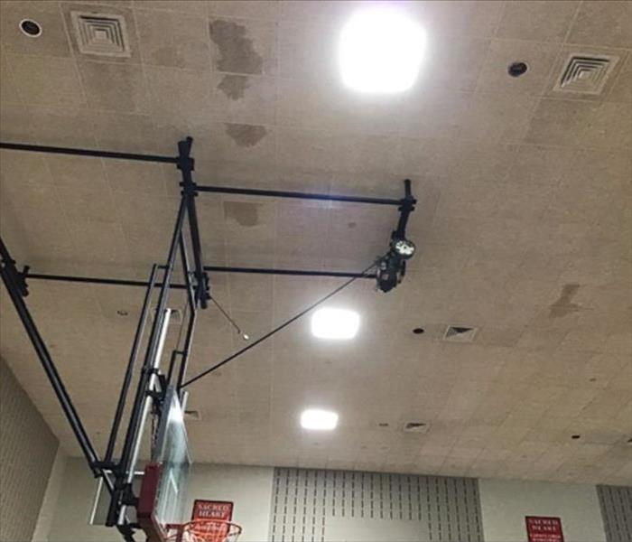 ceiling of gymnasium with water damage