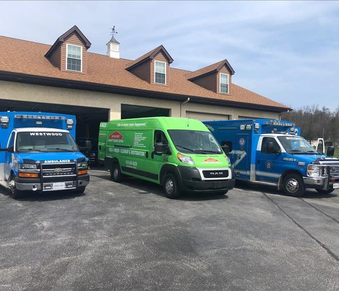 SERVPRO van parked near ambulances that we cleaned